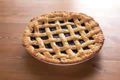 Blueberry Pie_2013-1. Blueberry Pie on a desk Royalty Free Stock Photography