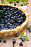 Blueberry pie and fresh berries on wooden table Royalty Free Stock Photography
