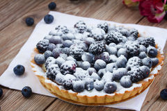 Blueberry pie. Fresh  tart with blueberry on wooden table Stock Photo