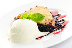 Blueberry pie and ice cream stock photography