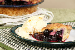 Blueberry pie with ice cream Stock Images