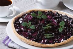 Blueberry pie with mint and black coffee horizontal closeup Royalty Free Stock Photo
