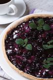 Blueberry pie with mint and black coffee vertical closeup Royalty Free Stock Images
