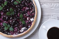 Blueberry pie with mint and black coffee on a wooden background Stock Images