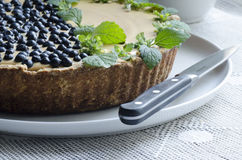Blueberry pie with mint served with knife Stock Photos