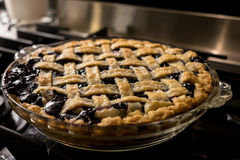 Blueberry pie on stove top Stock Photography