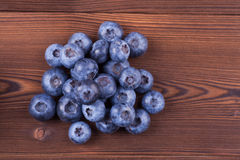 Blueberry pile. Pile of blueberries on wood background Stock Images