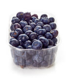 Blueberry in plastic container box isolated on white Royalty Free Stock Photos