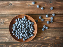 Blueberry in the plate. On the wooden table Stock Images