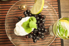 Blueberry, quark, mint and lime dessert. On a tablet Stock Photos