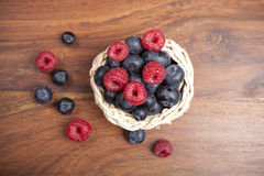 Blueberry and raspberry fruits, top view stock photography