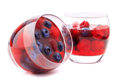 Blueberry and raspberry in glasses isolated on. Blueberry and raspberry jelly in in glasses isolated on white Royalty Free Stock Images