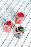 Blueberry and raspberry jam in mason jar on white Stock Images