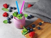 Blueberry And Raspberry Milkshake Yogurt stock image