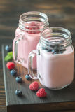 Blueberry and raspberry smoothies. On the wooden board Royalty Free Stock Image