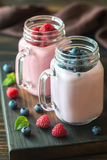 Blueberry and raspberry smoothies. On the wooden board Royalty Free Stock Images