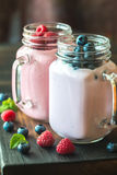 Blueberry and raspberry smoothies. On the wooden board Royalty Free Stock Photo