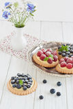 Blueberry and raspberry tartlets. On a silver platter Stock Photo
