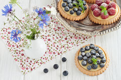 Blueberry and raspberry tartlets Stock Photo