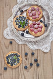Blueberry and raspberry tartlets. On a silver platter Stock Photos