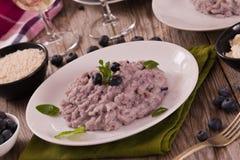 Blueberry risotto with mascarpone. Blueberry risotto with mascarpone on white dish royalty free stock photo