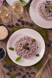 Blueberry risotto with mascarpone. Blueberry risotto with mascarpone on white dish royalty free stock images