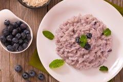 Blueberry risotto with mascarpone. Blueberry risotto with mascarpone on white dish royalty free stock image