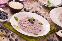 Blueberry risotto with mascarpone. Blueberry risotto with mascarpone on white dish stock photo