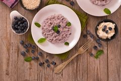 Blueberry risotto with mascarpone. Blueberry risotto with mascarpone on white dish stock photos