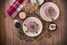 Blueberry risotto with mascarpone. Blueberry risotto with mascarpone on white dish stock photography
