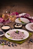 Blueberry risotto with mascarpone. Blueberry risotto with mascarpone on white dish royalty free stock photography