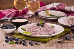 Blueberry risotto with mascarpone. Blueberry risotto with mascarpone on white dish royalty free stock photos