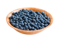Blueberry in round wooden plate. Isolated on white Stock Photo