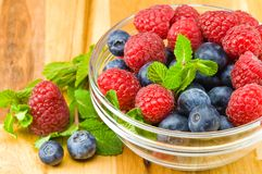 Blueberry, ruspberry and mint leaves Stock Photography