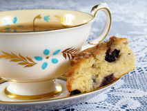 Blueberry Scone & Tea. Blueberry scone with a cup of tea Royalty Free Stock Image