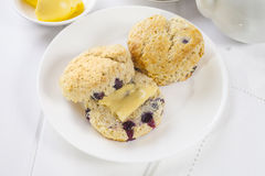 Blueberry Scones with Butter Royalty Free Stock Image