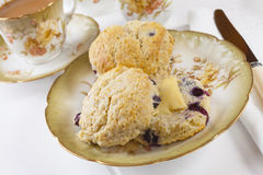 Blueberry Scones with Butter and a Cup of Tea Stock Photo