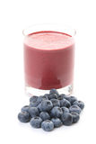 Blueberry shake. Glass of delicious shake and some fresh fruits isolated on white stock photos
