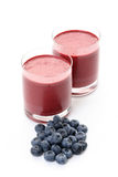 Blueberry shake. Glass of delicious shake and some fresh fruits isolated on white royalty free stock photos