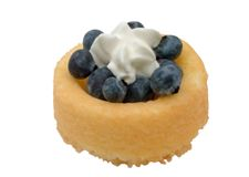 Blueberry ShortCake and Cream. Blueberries on a shortcake with whipped cream on top, isolated Stock Photo