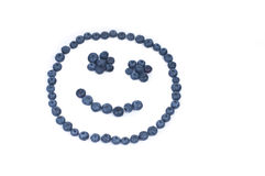 Blueberry smiley face Stock Images