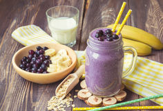 Blueberry smoothie with banana and oat flakes. In jar Royalty Free Stock Photos