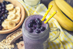 Blueberry smoothie with banana and oat flakes. In jar Stock Images