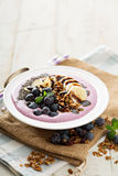 Blueberry smoothie bowl with banana and chia seeds Royalty Free Stock Photography