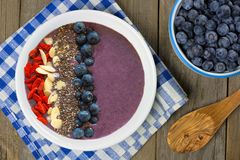 Blueberry smoothie bowl overhead table scene Stock Images