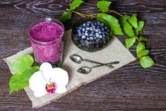 Blueberry smoothie on dark wood, still life Stock Photography