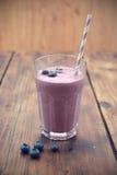 Blueberry smoothie. Fresh Blueberry smoothie on wooden table Royalty Free Stock Photo