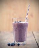 Blueberry smoothie. Fresh Blueberry smoothie on wooden table Royalty Free Stock Photos