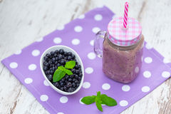Blueberry smoothie in a glass jar Stock Image