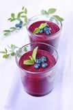 Blueberry smoothie in glasses Stock Photo